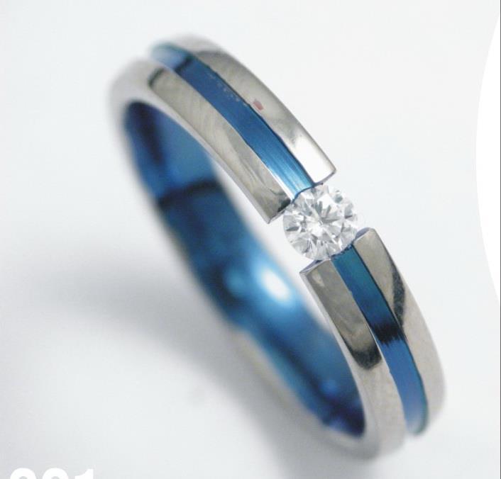Titán gyűrű színesre oxidálva, gyémánttal 147.