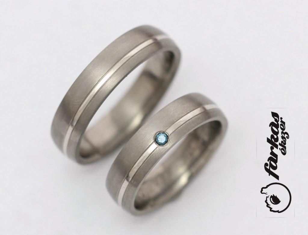 Titán-palládium karikagyűrűk kék gyémánttal 210.