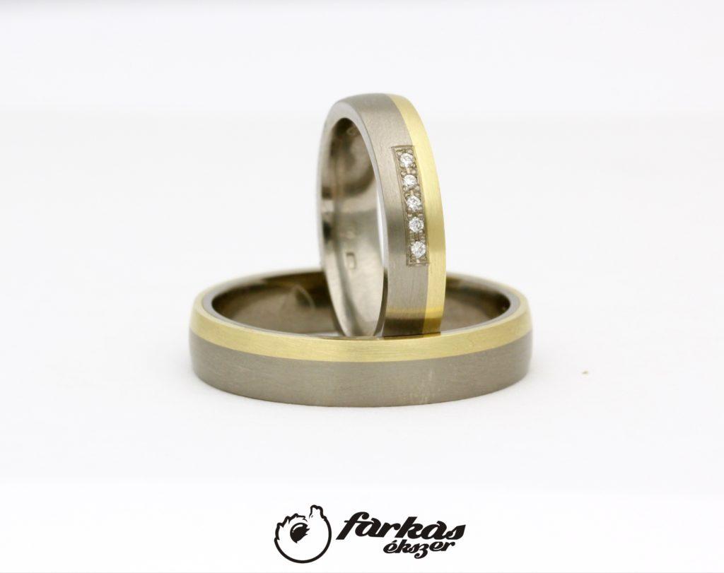 Titán-arany karikagyűrűk gyémántokkal T306.